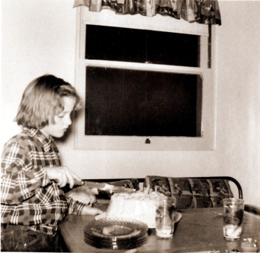 Donna with The Cake in the kitchen of the Oak Drive house.