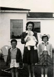 Tom, Harriet holding Donna, Jean.  1946 San Diego California